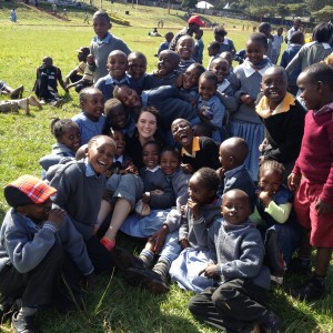 Kelsey surrounded by the children at the MERU AGRICULTURAL SHOW