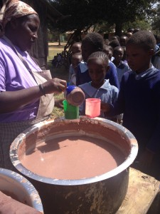 Porridge is made from freshly ground sorghum, amaranth, millet, finger millet and maize and cooked over an open fire.  Approximately 200 students are fed every day at this school.