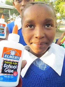 Here I am with my very own glue and a beautiful school uniform.  I could never imagine this was possible!