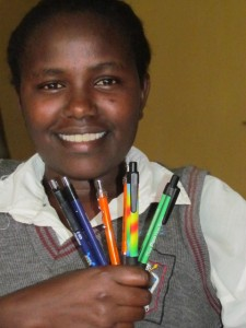 This photo was taken during the most recent mission.   I am holding some of the pens  given to me.  Bless them for all they do!