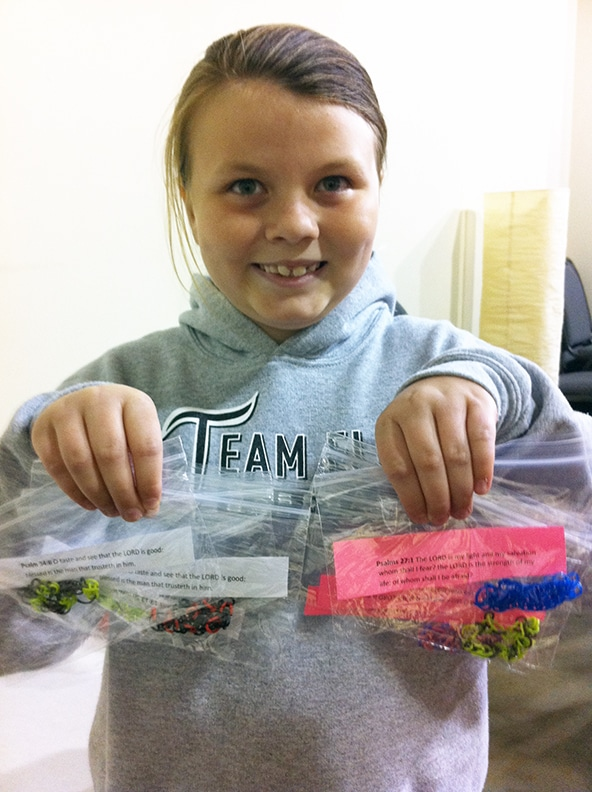Grace holding up a few of the bracelets she made for our kids in Kenya.