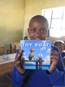 Jeff Wambugu, sponsored by BJ and Harry, receives a book during the Matanya's Hope mission.
