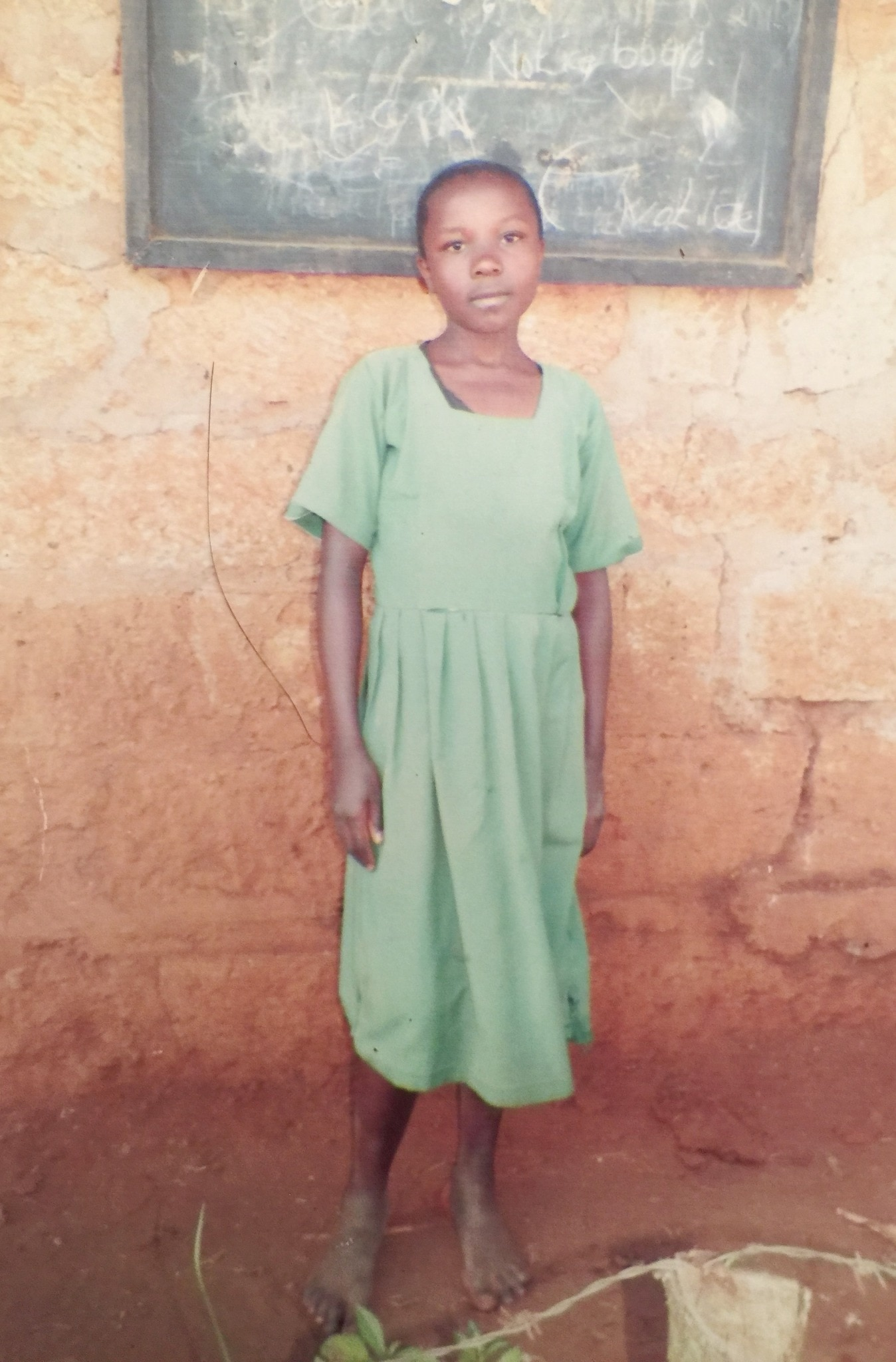 This is Pamela; she is in 5th grade.  She is an orphan.  People in the impoverished community contributed money until they could make her a dress.  Thanks to my Synagogue, Pamela is sponsored and can now go to school.