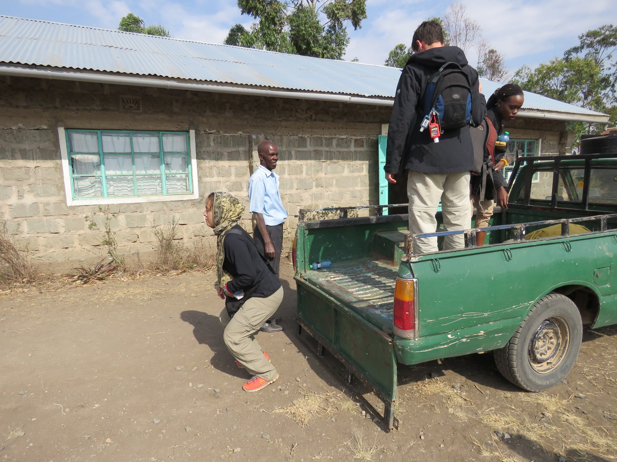 Jumping down from the pick up in front of Matanya Primary School