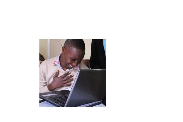 Solomon Maina receives computer from his sponsors Sue and Jack.  He was speechless!