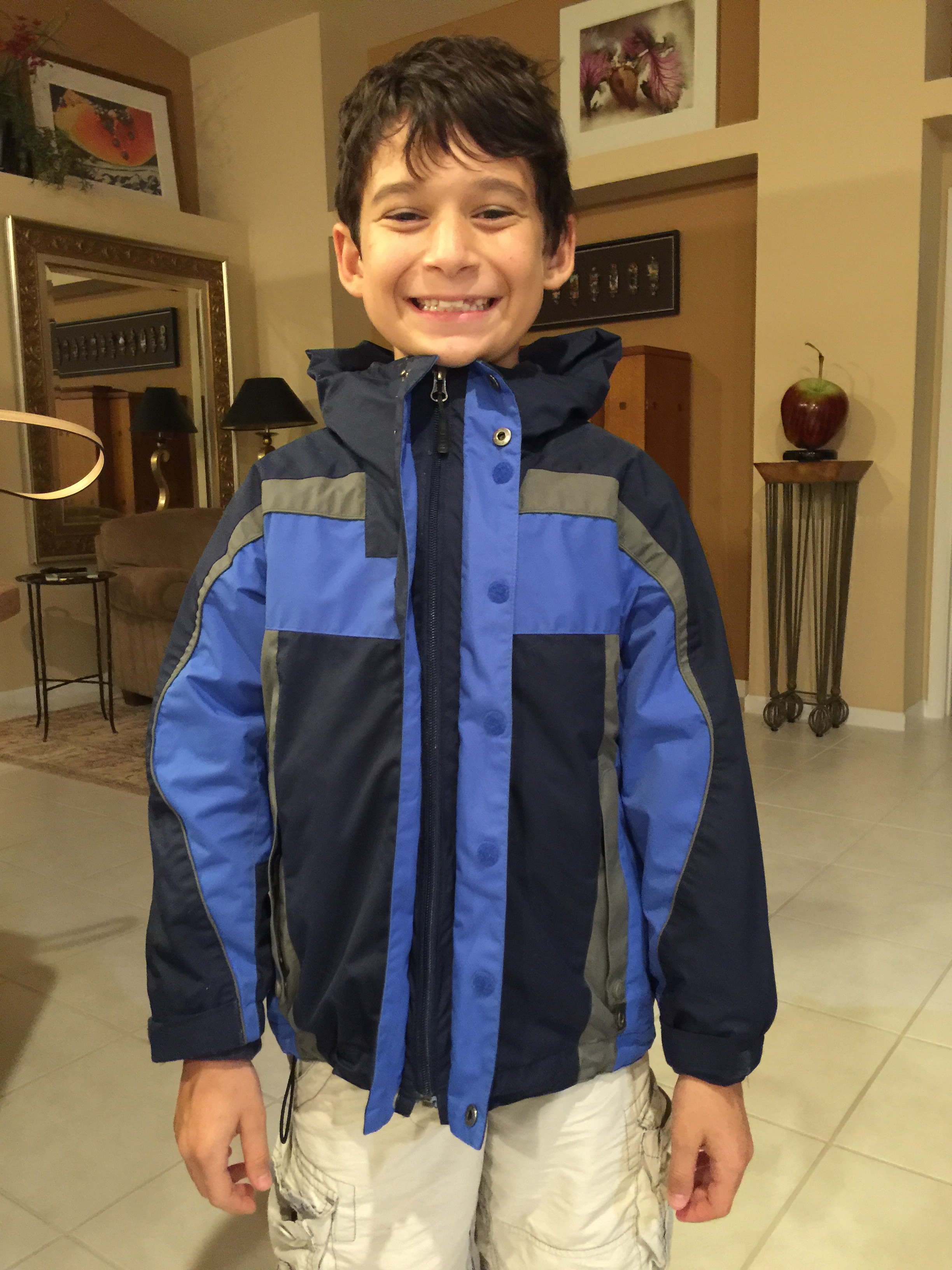 Here, my sweet friend Sammie wears his coat one last time before sending it to Kenya where it will help a boy in need.