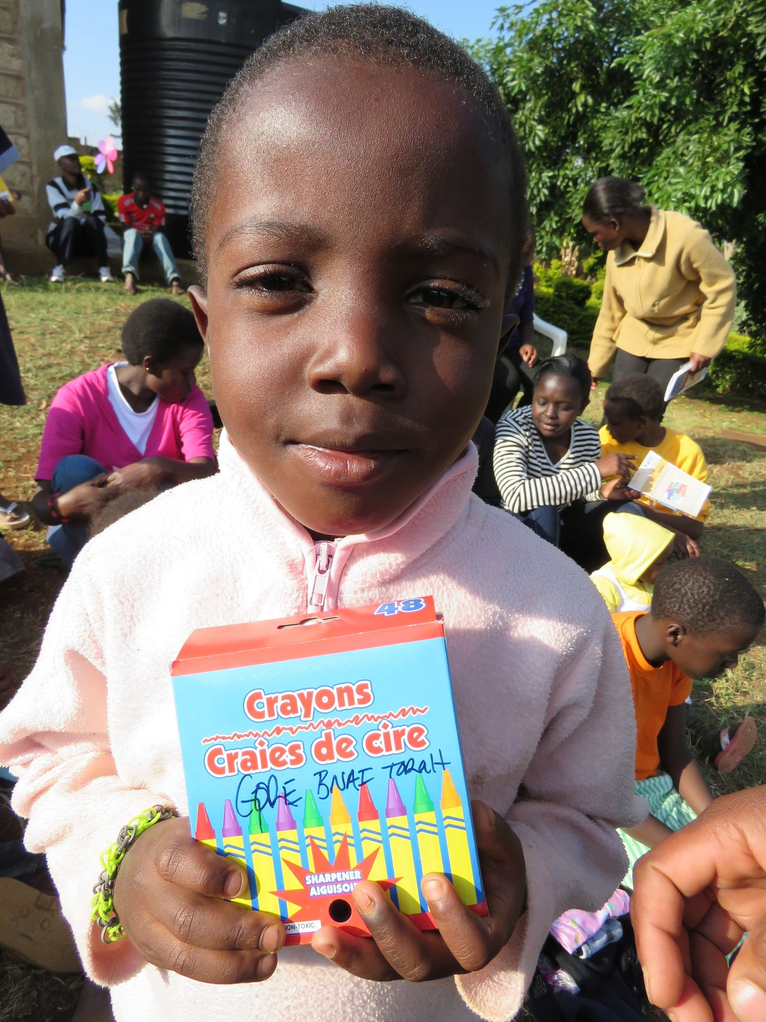 This little boy is also an orphan.  He was happy to get one of the many boxes of crayons our family sent for the children.