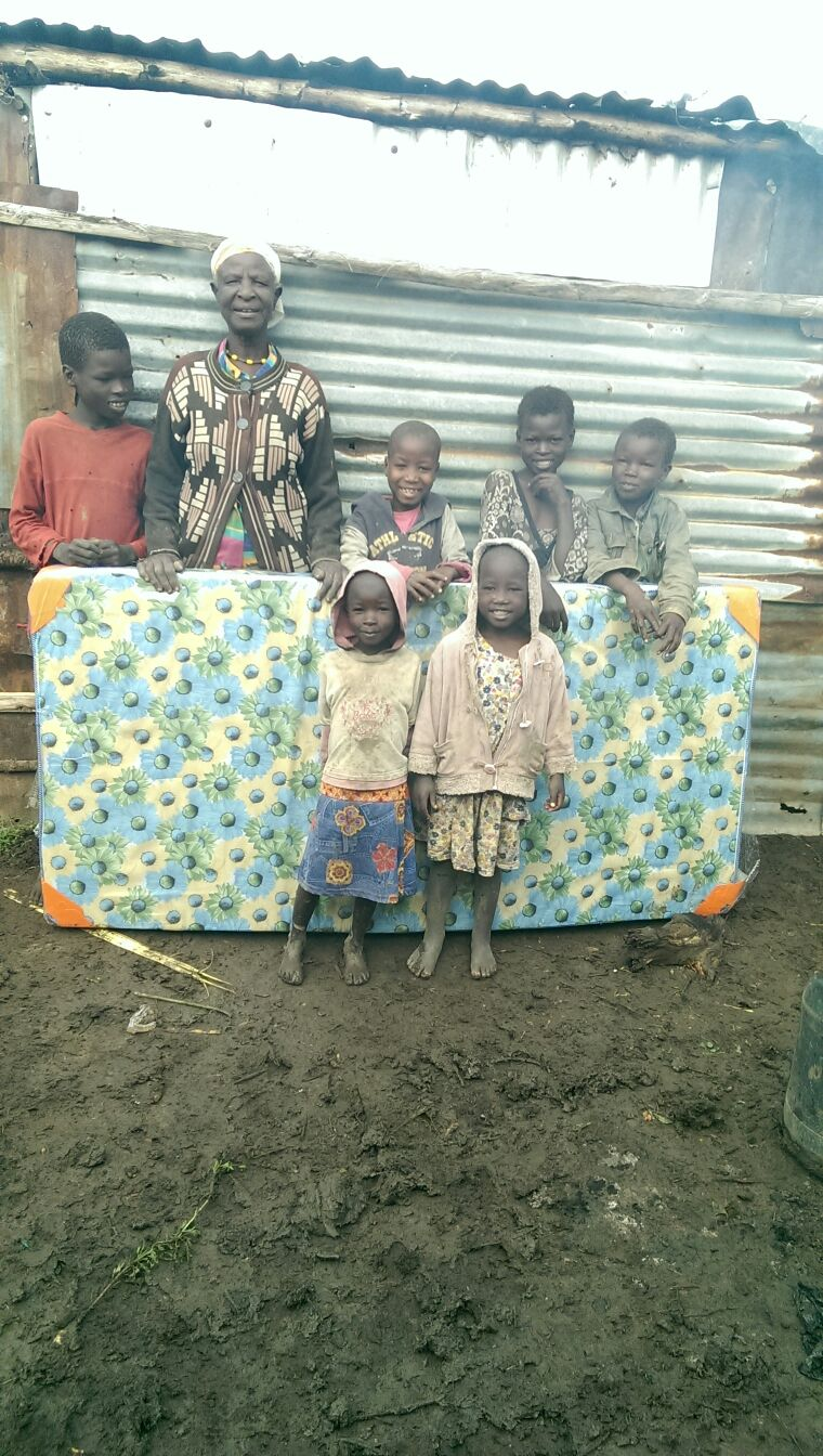Cucu (Grandmother to Matanay's Hope student Jackline Gachohie) takes care of her 8 orphaned grandchildren. When Matanya's Hope donated 2 mattresses to her several years ago, she gave them to her grandchildren while she continued to sleep on the floor.  Your donations helped us bring the blessing of a new mattress to cucu this Christmas.