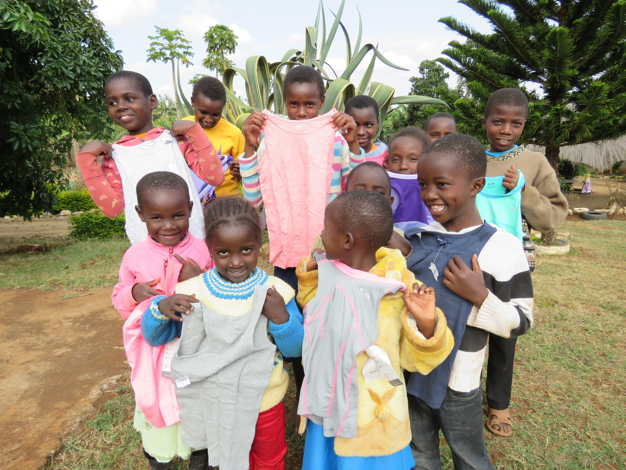 Children from an orphanage receive the gift of clothing from Matanya's Hope donors.