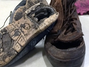 A photo of some of the shoes and other personal items our children in Kenya wear due to the extreme poverty their families face