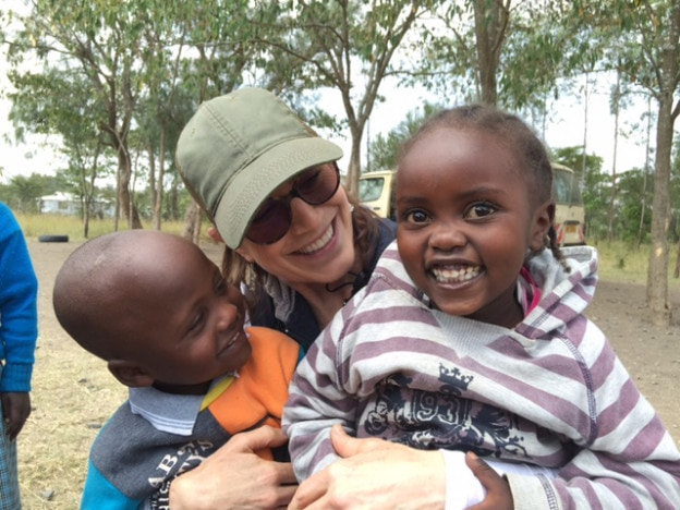Matnaya's Hope founder, Michelle Stark with two children from Matanya Primary School.  Photo taken during Mission 2016