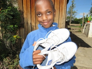 Naishorwua after receiving shoes from MH donations.