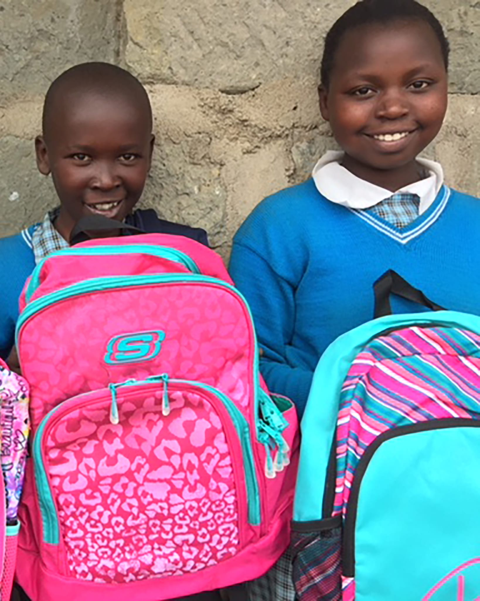 School children receiving book bags donated by the Dawn Brancheau Foundation in loving memory of Dawn.