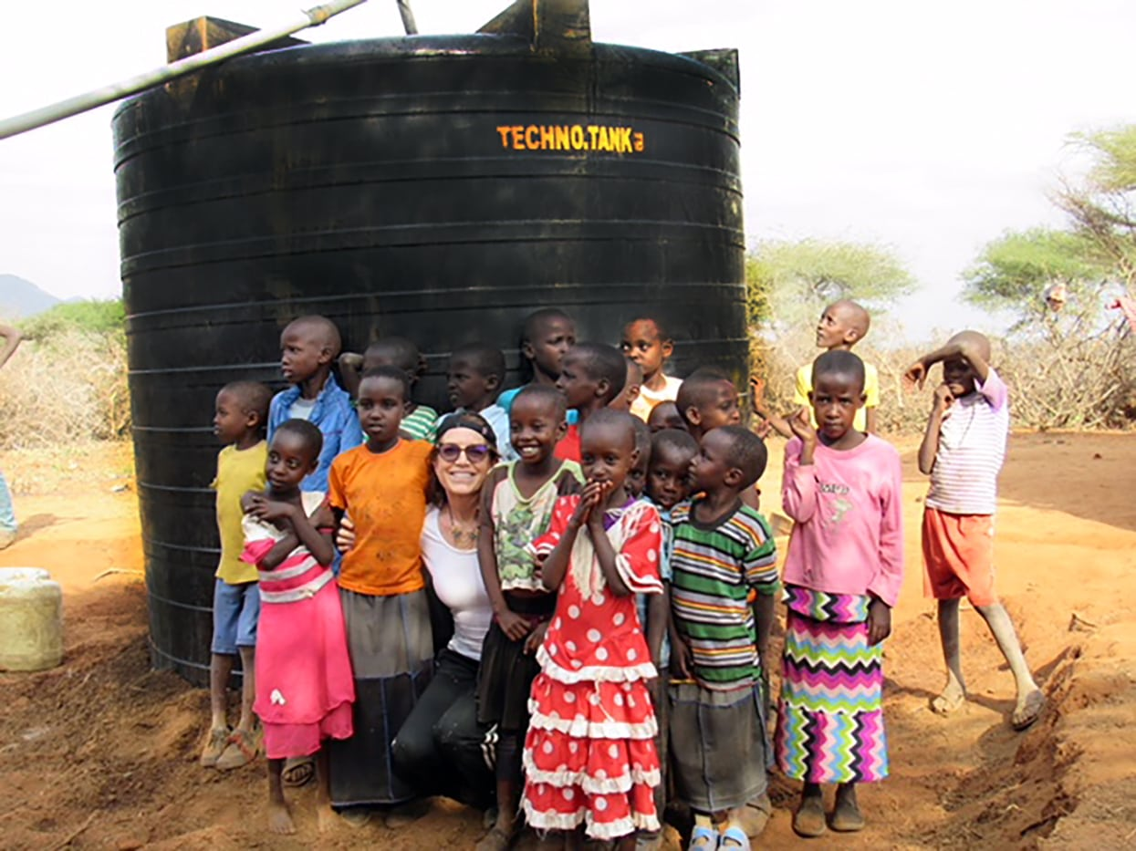 The children of this Masai village gather with me around their new tank, donated this year.