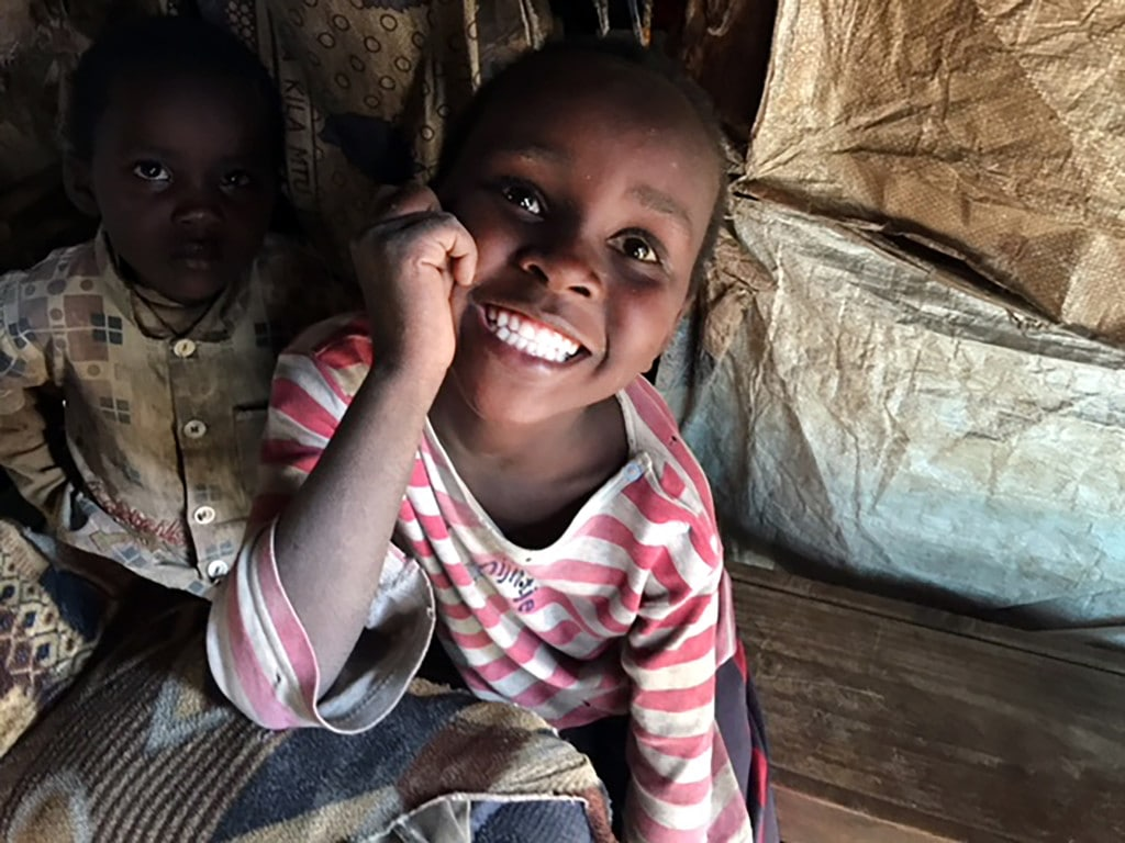This is Sabina Nyaguthi.  She dreams of going to school like the other children, but fees often prevent her from attending class.