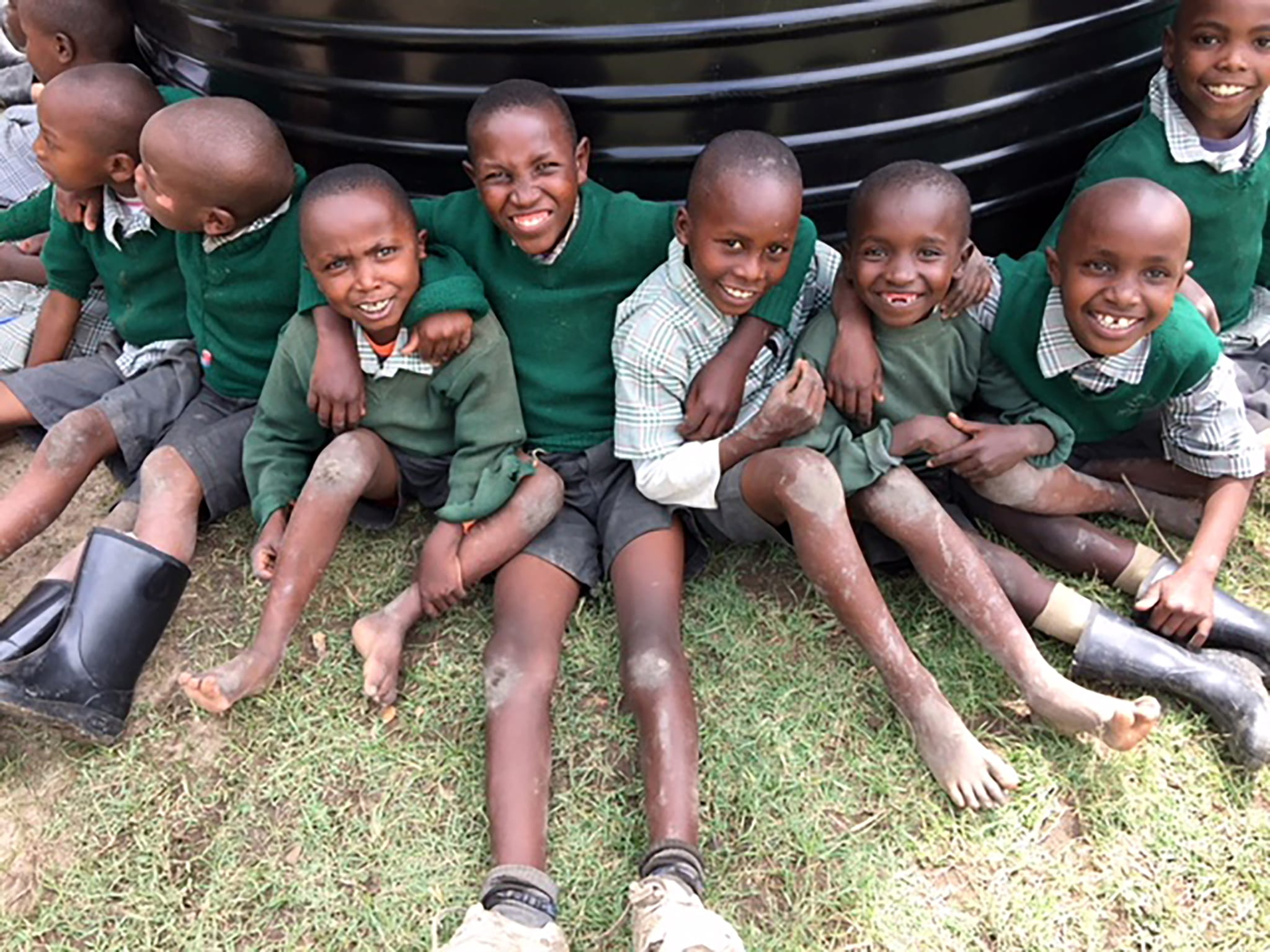 Students from CCM primary school in Nanyuki gather around the rainwater tank donated by Matanya's Hope
