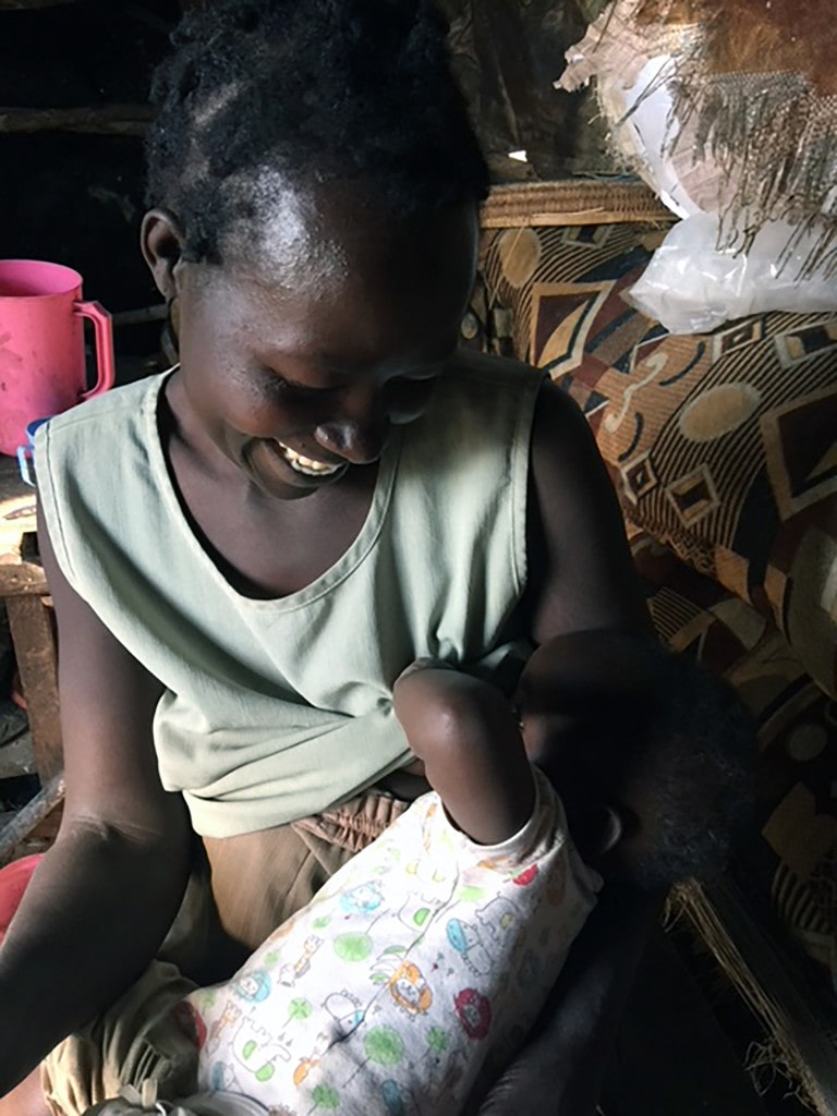 NEED FOR HOUSE - MOTHER FEEDING CHILD