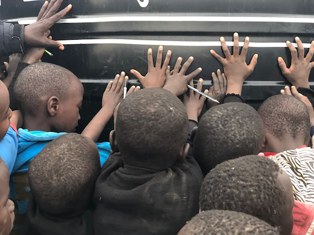 These children are praying over a 10,000 liter rainwater storage tank made possible through donations to MH.  Prior to the tank being place, the children suffered from dehydration and related issues including lack of ability to focus