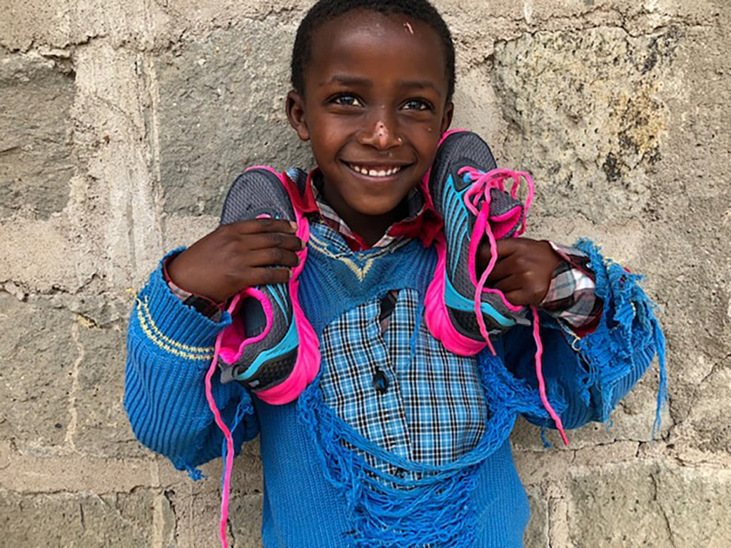 This little guy was thrilled to receive the gift of shoes through your donations.