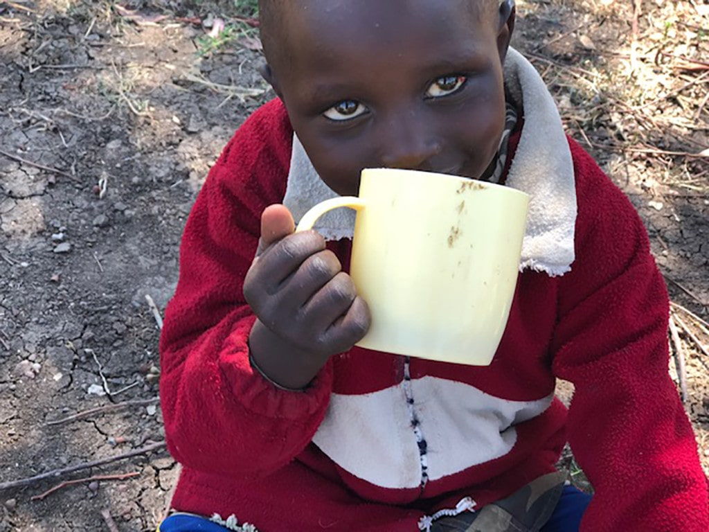 This little girl enjoys a daily cup of porridge made possible through donations to the Matanya's Hope porridge program.  Without such donations, she may be one of countless children who go days without a single meal.