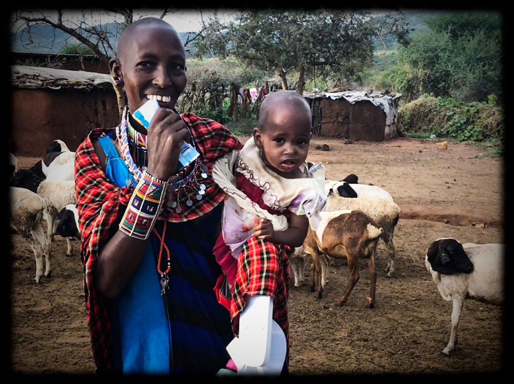 How we tie in: The Maasai in Kenya traditionally live among their goats and cows.  Goat milk is plentiful and is highly nutritious.  This Maasai woman and her child are pictured here after receiving a gift of Garden of Life Protein bars.