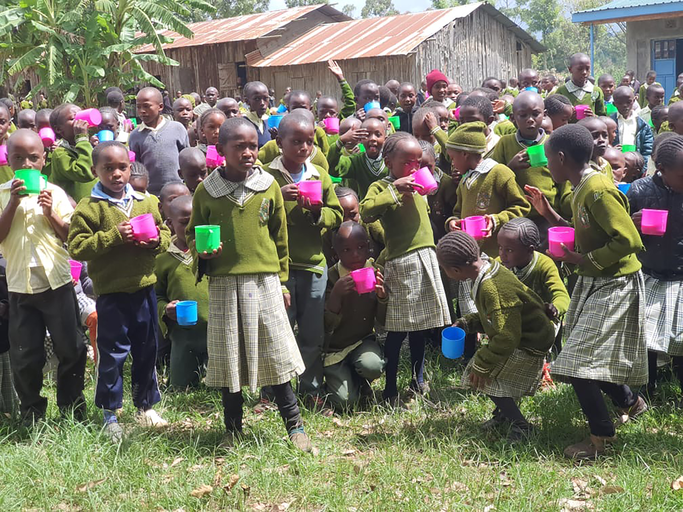 Hundreds of children enjoy their first day of porridge at a needy school in Naro Moru.
