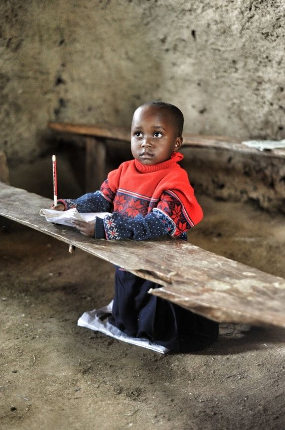 Classrooms in rural Kenya rarely have concrete floors.  Blackboards are painted on the cracked walls.  Children gather, hungry for education. Hungry for food.